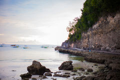 Tropical beach at sunset on an exotic island Stock Images