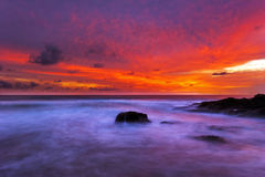 Tropical beach at sunset. Stock Photos