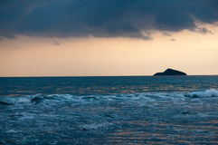 Tropical beach sunset, romantic getaway. Tropical beach sunset with orange sky Stock Photo
