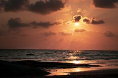 Tropical beach in sunset time. At Thailand Stock Image