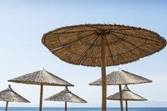 Tropical beach sunshades Stock Photo