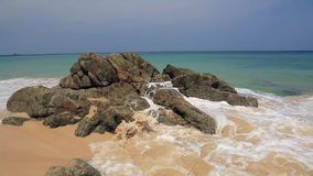 Tropical beach surf. Sunny Day at tropical beach with stones, Phuket stock video footage