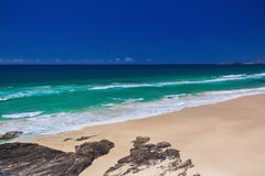 Tropical beach with surf waves on Gold Coast, Australia Stock Photos
