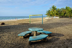 Tropical beach with a table and football goals Stock Images