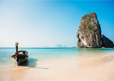 Tropical beach with thai boat and cliff rocks in the sea. Thailand, Krabi Royalty Free Stock Photo