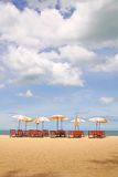 Tropical beach, Thailand. Deckchairs and parasol on the white sand beach facing the Cha-Am beach. Thailand Stock Photography