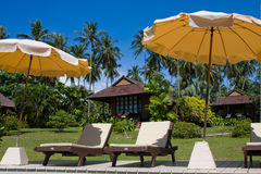 Tropical beach in Thailand. Tropical beach chair next to the pool in Thailand Stock Images