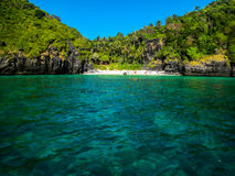 Tropical island. White sandy beach with rich vegetation and emerald water in Thailand Royalty Free Stock Photos
