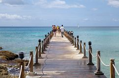 Tropical beach and tourists Royalty Free Stock Images