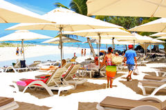 Tropical beach and tourists Stock Images