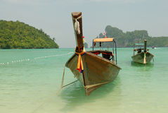 Tropical beach, traditional long tail boats, Andaman Sea, Thailand Stock Images
