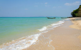 Tropical beach, traditional long tail boats, Andaman Sea. Stock Images