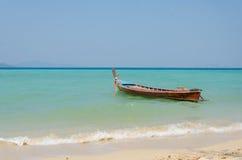 Tropical beach traditional long tail boats, Andaman Sea. Royalty Free Stock Photos