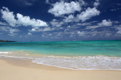 Tropical Beach Turquoise Ocean fluffy Clouds Hawaii. Stock Photography