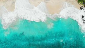 Tropical beach with turquoise ocean water and waves, aerial view. Top view of paradise island. Tropical beach with turquoise ocean water and waves, aerial view stock footage