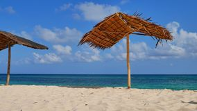 Tropical beach in UHD. Bamboo parasol at the tropical beach UHD stock video footage