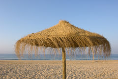 Tropical beach umbrella. Straw umbrellas Stock Photography