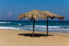 Tropical beach with umbrella in cyprus Royalty Free Stock Photos