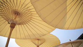 Tropical beach umbrella or parasol, vintage style : panning HD.  stock video footage