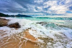 Tropical beach under gloomy sky Royalty Free Stock Photos