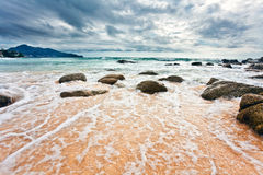 Tropical beach under gloomy sky Royalty Free Stock Photos