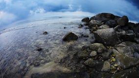 Tropical beach under gloomy sky. Fish-eye view stock video