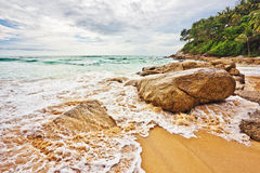 Tropical beach under gloomy sky Stock Images