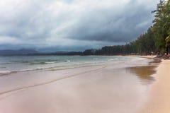 Tropical beach under gloomy sky Stock Images