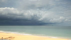 Tropical beach under gloomy sky. Nature background stock footage