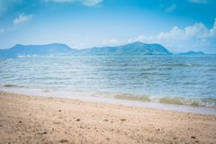 Tropical beach view. Calm and relaxing empty beach scene, blue sky and white sand. Tranquil nature concept. stock image