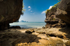 Tropical beach view from karst limestone cave. Ocean landscape u Royalty Free Stock Images