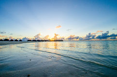 Tropical beach view at sunset time Stock Image