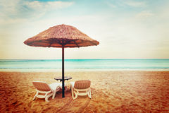 Tropical beach view. Two beach chairs. Royalty Free Stock Photo