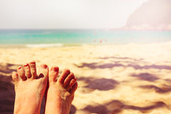 Tropical beach. Vintage effect. Legs. Royalty Free Stock Photo