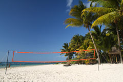 Tropical beach with volleyball net Stock Photography