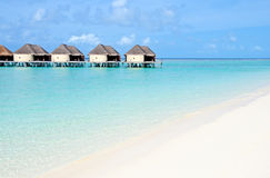 Tropical beach with water villas Royalty Free Stock Images