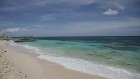 Tropical beach. Wave running on coast of island stock footage