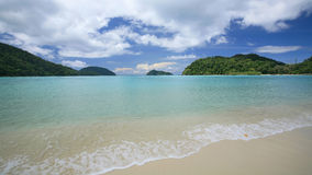 Tropical beach with wave and transparent sea Stock Images