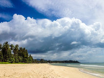 Tropical beach, white clouds Royalty Free Stock Photos