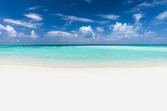Tropical beach with white sand and clear turquoise ocean. Maldiv Stock Photography