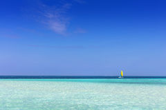 Tropical beach with white sand and clear turquoise ocean. Maldives Royalty Free Stock Image