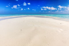 Tropical beach with white sand and clear turquoise ocean. Maldives Royalty Free Stock Photography