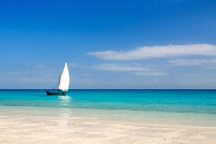 Tropical beach. White sand tropical beach and traditional African boat Royalty Free Stock Photography