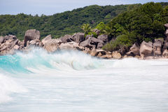 Tropical beach, wild waves, turquise water of the Indian ocean next to typical granite rocks of Seychelles Royalty Free Stock Images