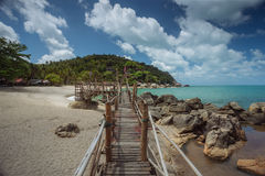 Tropical beach. Wooded bridge to a tropical beach Stock Image