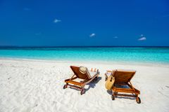 Tropical beach. Wooden lounge chairs on a beautiful tropical beach at Maldives Stock Images