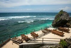 Tropical beach with wooden a sun lounger Stock Photo