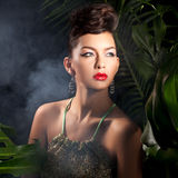 Tropical Beauty. Beauty Portrait of Model in Tropical Setting Highlighting Glamorous Cosmetics Royalty Free Stock Photos