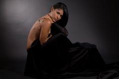 Tropical beauty in black velvet Royalty Free Stock Image
