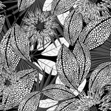 Tropical black and white spotted flowers in a seamless pattern stock illustration